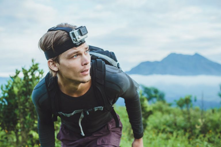 Attractive Traveler vith GoPrO camera on his forehead