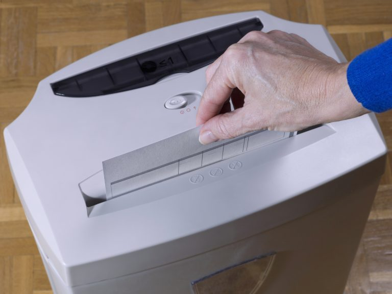 introducing a paper into a shredder