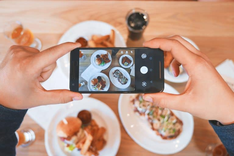 a person taking picture of his food